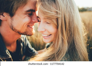 Young happy couple hugging and laughing. Space for text. Close-up.