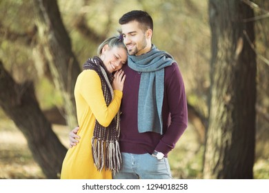 Young happy couple hugging in park
