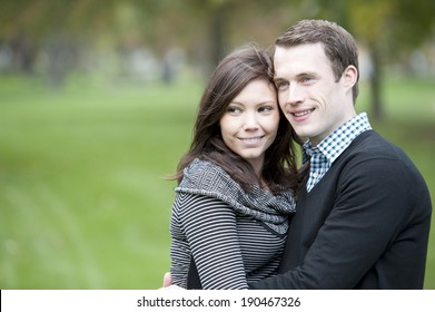 A young and happy couple looking to the left with room for copy space.