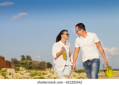 Young happy couple in love at the summer picnic. Outdoors portrait