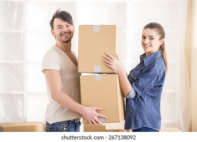 The young happy couple. Moving, purchase of new habitation.
