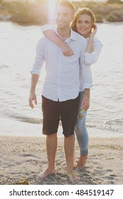 Young happy couple on the beach, selective focus