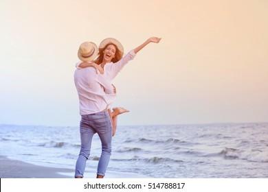 Young happy couple on seashore