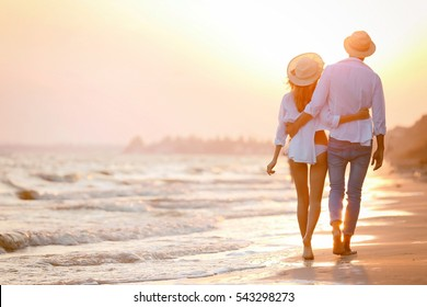 Young happy couple on seashore