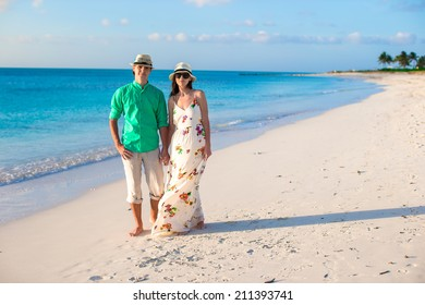 Young happy couple on summer tropical vacation in the evening