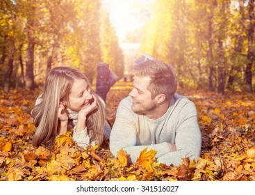 Young happy couple outdoors in autumn