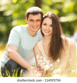 Young happy couple in the park