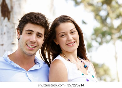 Young happy couple in the park in the summer