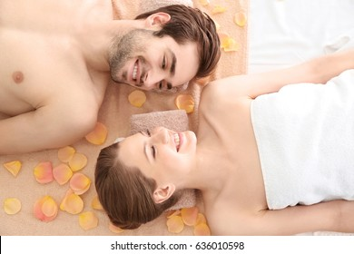 Young happy couple relaxing in spa salon