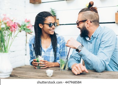 Young happy couple sitting at cafe