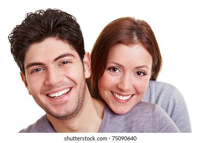 Young happy couple smiling into the camera