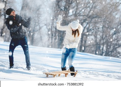 Young Happy Couple Snow Fighting Having Fun in Snowy Mountain
