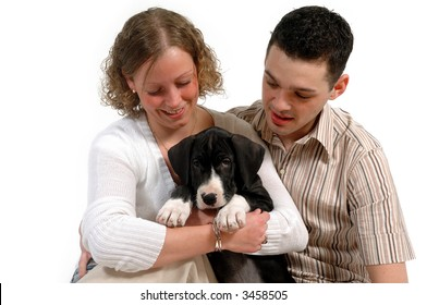 Young happy couple and sweet puppy