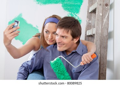 Young happy couple taking a snapshot of themselves with cellphone
