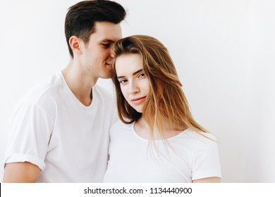 Young Happy Couple together against white background.,