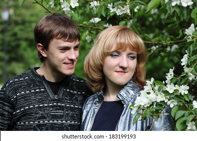 Young happy couple is walking in the park.