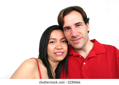 Young happy couple wearing red.