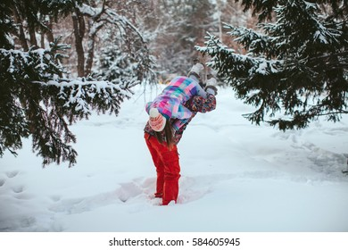 Young happy couple in winter forest. walk and play the fool