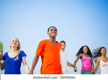 Young Happy Diverse People Holding Hands