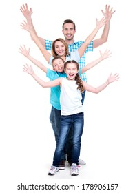 Young happy family with children raised hands up - isolated on white background