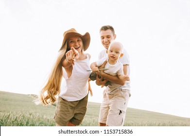 a young happy family in the field have a fun