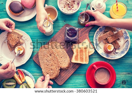 Young Happy Family Having Breakfast