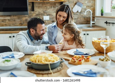 Young happy family having fun during lunch time at dining table.  - Shutterstock ID 1681261498