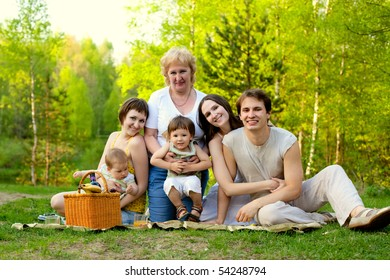 young happy family having picnic in the nature