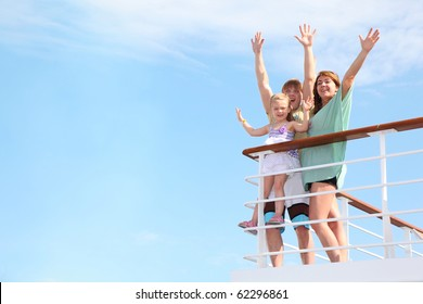 young happy family with little girl with hands up, rests on yacht and is glad at life from soul