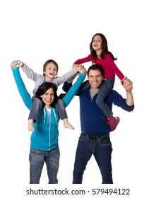 young happy family mother and father playing with little son and daughter having fun carrying the children on shoulders all together isolated on white background