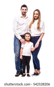 Young Happy family on white background. Mother, father and daughter
