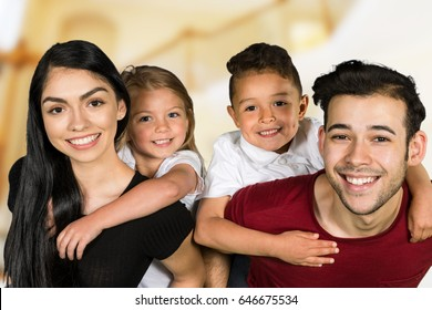 Young happy family smiling and laughing together