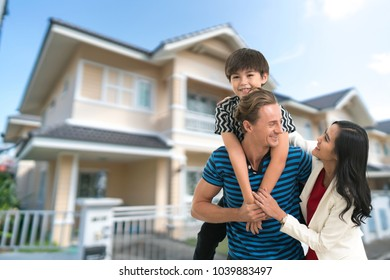 Young happy family of three having fun together outdoor.