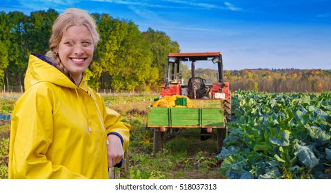 Young happy farm girl on the field