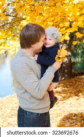 Young happy father with daughter in autumn park