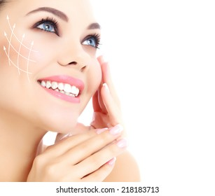 Young happy female with clean fresh skin, white background