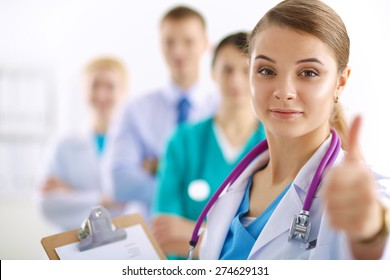 Young happy female doctor showing thumbs up.