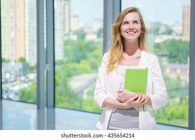 young happy female in office