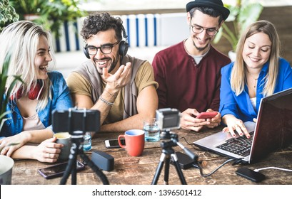 Young happy friends sharing content on streaming platform with digital web camera - Modern marketing concept with millenial guys and girls having fun vlogging live feeds on social media network