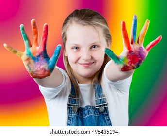 young happy girl.  Child hands painted in colorful paints. Children's hand in the paint  on colorful background