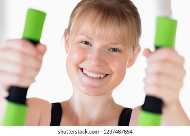 Young Happy Girl Doing Dumbbell Exercises Stock Photo (Edit Now