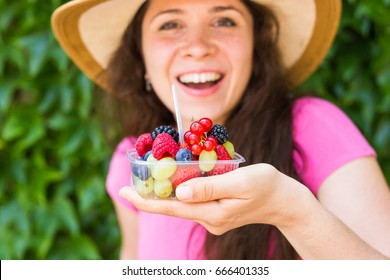 Young happy girl with fresh berries