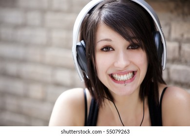 Young happy girl listening to music.