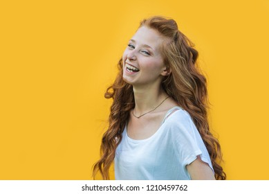 Young happy girl on colored background