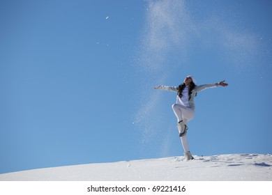 young happy girl plays with a snow