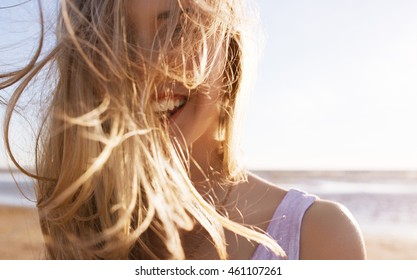 Young happy girl smiling. Wind in hair
