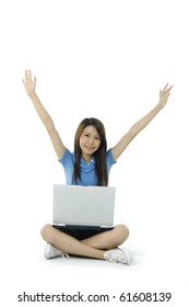 Young happy girl using a laptop with her legs crossed on a white background