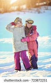 Young happy girls have fun on a winter sunny day