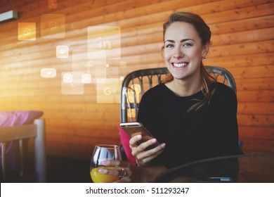 Young happy hipster girl with mobile phone in hands looking to the camera.Cheerful female student using cell telephone. Infographics design elements of popular social network application and programs