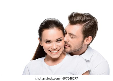 young happy hugging couple, isolated on white